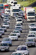 Traffic congestion cars and trucks in all carriageways on M25 motorway, London, United Kingdom