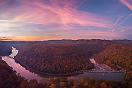 An array of pinks, purples and hints of orange signal the arrival of the morning sun over an Autumn landscape at Hawk's Nest State Park in West Virginia.