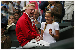 © Licensed to London News Pictures. 12/07/2015. London, UK. <br /> Boris Becker talks to a pretty girl after Novak Djokovic (SRB) beats Roger Federer (SUI)  in the finals of the Wimbledon Tennis Championships today. 1<br /> Photo credit: LNP