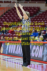 03 January 2014:  Referee Laura Morris signals a completed three point shot during an NCAA women's basketball game between the Drake Bulldogs and the Illinois Sate Redbirds at Redbird Arena in Normal IL