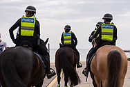 Officers from the Mounted Branch of Victoria Police on patrol during the final days of the worlds toughest and longest COVID-19 restrictions in St Kilda.  With 21 days of zero new cases, Premier Daniel Andrews is expected to announce major easing of restrictions, including masks, at his press conference on Sunday. (Photo by Dave Hewison/Speed Media)