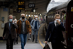 © Licensed to London News Pictures. 20/05/2021. London, UK. Passengers wearing face masks disembark a train at Victoria Station in central London. Government has announced that the rail network will be rebranded Great British Railways as part of a restructuring, replacing current franchise arrangements. Photo credit: Ben Cawthra/LNP