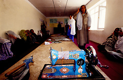 FAIZABAD, 27 July 2005..Women learn how to sew by machine at the Women Affairs Department.....This is part of the Vocational Training Centre, funded by UNFPA and implemented by IBNSINA...The VTC aim is to improve the status of women, by providing them a two-hour daily course on Reproductive Health, literacy and working skills.