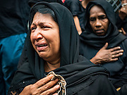 24 OCTOBER 2015 - YANGON, MYANMAR:  Shia women weep during Ashura observances at Mogul Mosque in Yangon. Ashura commemorates the death of Hussein ibn Ali, the grandson of the Prophet Muhammed, in the 7th century. Hussein ibn Ali is considered by Shia Muslims to be the third imam and the rightful successor of Muhammed. He was killed at the Battle of Karbala in 610 CE on the 10th day of Muharram, the first month of the Islamic calendar. According to Myanmar government statistics, only about 4% of the population is Muslim. Many Muslims have fled Myanmar in recent years because of violence directed against Burmese Muslims by Buddhist nationalists.    PHOTO BY JACK KURTZ