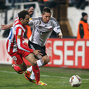 Besiktas's Filip Holosko (R) and Atletico Madrid's Juanfran (R) during their UEFA Europa League Round of 16, Second leg soccer match Besiktas between Atletico Madrid at Inonu stadium in Istanbul Turkey on Thursday March 15, 2012. Photo by TURKPIX