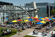 Google Inc. employees gather for lunch in the main courtyard of Google Inc. headquarters in Mountain View, Calif., on Wednesday, May 16, 2007. ...PHOTOGRAPHER: Erin Lubin/Bloomberg News.