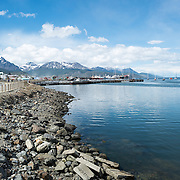 The waterfront of Ushuaia Harbor, with the main port complex in the distance and the town off to the left.