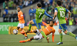 November 30, 2017 - Seattle, Washington, U.S - Soccer 2017: Seattle midfielder CRISTIAN ROLDAN (7) avoids a  tackle by JUAN DAVID CABEZAS (5) as the Houston Dynamo play the Seattle Sounders in the 2nd leg of the MLS Western Conference Finals match at Century Link Field in Seattle, WA. (Credit Image: © Jeff Halstead via ZUMA Wire)