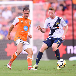 BRISBANE, AUSTRALIA - MARCH 31: Eric Bautheac of the Roar passes the ball under pressure from Kye Rowles of the Mariners during the Round 25 Hyundai A-League match between Brisbane Roar and Central Coast Mariners on March 31, 2018 in Brisbane, Australia. (Photo by Patrick Kearney / Brisbane Roar FC)