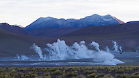 El Tatio is a geyser field located within the Andes Mountains of northern Chile at 4,320 meters above mean sea level. Its name means the grandfather. It is among the highest-elevation geyser fields in the world. El Tatio has over 80 active geysers, making it the largest geyser field in the southern hemisphere and the third largest in the world. Its geysers erupt to an average height of about 75 centimetres, with the highest eruption observed being around 6 metres.<br /> <br /> The site is a major tourist attraction. Visitors generally arrive at sunrise when each geyser is surmounted by a column of steam that condenses in the cold air. The steam plumes disappear as the air warms up. It is also possible to bathe in the hot geyser water in a small pool.