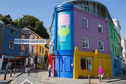 """@Licensed to London News Pictures 31/08/2017 Folkestone, Kent. '""""Folkestone Lighthouse"""" by Michael Craig-Martin stands at the bottom of the Old High Street during Folkestone Triennial 2017. Folkestone Triennial is the flagship project of the Creative Foundation, an independant arts charity enabling the regeneration of the seaside town of Folkestone in Kent through creative activity. Photo credit: Manu Palomeque/LNP"""