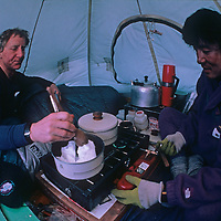 Geoff Somers and Keizo Funatsu melt snow for water in their tent at the South Pole, halfway through the 1989-1990 Trans-Antarctica Expedition.