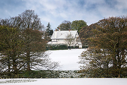 © Licensed to London News Pictures. 29/04/2016. Leeds UK. Picture shows snow capped houses in Roundhay Park this morning. Leeds woke to a covering of snow this morning & is expected to get further snow showers over the weekend. Photo credit: Andrew McCaren/LNP