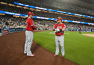 The Angels' C.J. Cron and Kole Calhoun chat before hitting against the Dodgers during their Freeway Series game Friday night at Dodger Stadium.<br /> <br /> <br /> ///ADDITIONAL INFO:   <br /> <br /> freeway.0402.kjs  ---  Photo by KEVIN SULLIVAN / Orange County Register  --  4/1/16<br /> <br /> The Los Angeles Angels take on the Los Angeles Dodgers at Dodger Stadium during the Freeway Series Friday.<br /> <br /> <br />  4/1/16