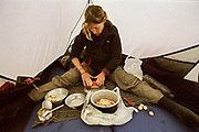 Yet another attempt at fancy cooking while it rains: we try our luck at Tuna dumplings - it's a semi-success. Near Chaqmaqtin Lake.<br /> <br /> Adventure through the Afghan Pamir mountains, among the Afghan Kyrgyz and into Pakistan's Karakoram mountains. July/August 2005. Afghanistan / Pakistan.