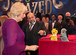 Embargoed to 0001 Tuesday November 13 The Duchess of Cornwall meeting puppets Sooty and Sweep after the We Are Most Amused and Amazed performance at the London Palladium.