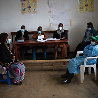 The Vighole village health committee meeting at their new installations. Local health infrastructure was improved and the health teams in the area were supported and strengthened during the Ebola crisis which ended in June 2020. Vighole is near Butembo, North Kivu, DRC.
