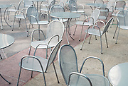 empty chairs and tables in a public square