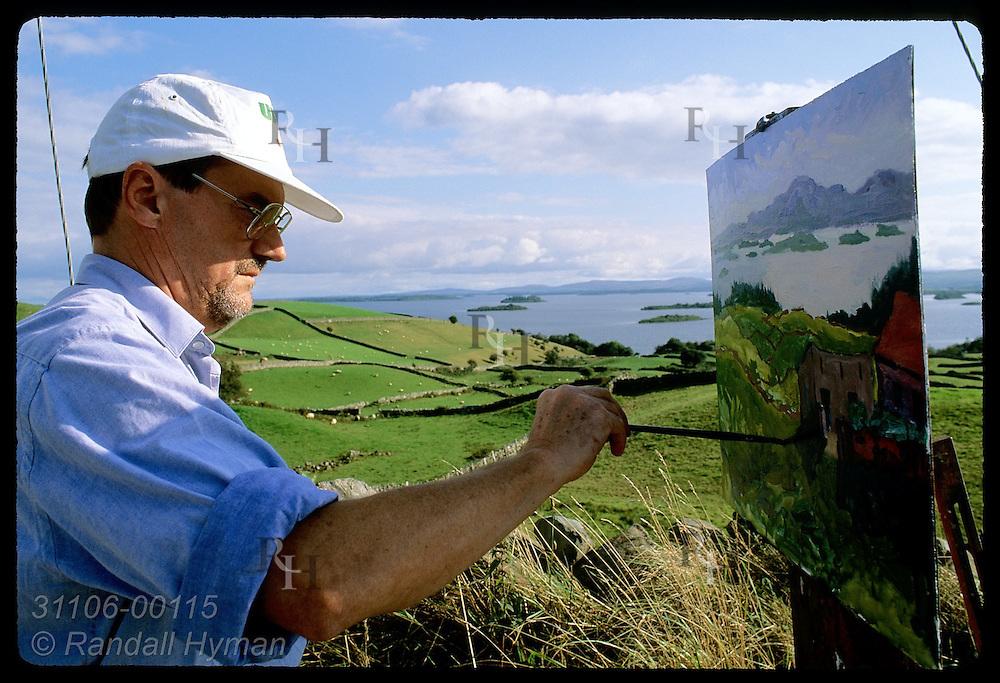 Professional artist John Dinan paints pastoral scene along Lough Corrib near Clonbur; County Galway, Ireland.