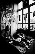 A cobbler works in his shop in Tbilisi, Soviet Georgia - 1990
