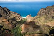 Honopu Valley and Na Pali Coast sea cliffs seen via helicopter over island of Kauai, Hawaii, USA.