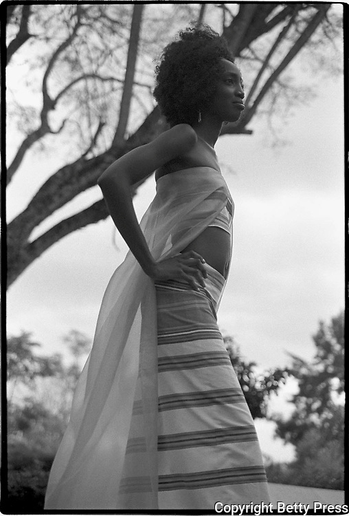 Life is the ability to breathe out every time you breathe in. Ugandan proverb<br /> <br /> A model shows off a new design by a prominent Kenyan fashion designer. There is immense talent and sophistication on the African continent in the fields of fashion, music and the arts. Nairobi, Kenya  2002