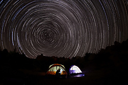 August 18, 2017 - California Desert, U.S. - Campers get set for sleep as star trails spin late night above the Joshua Tree National Park in California a few days before total solar eclipse. (Credit Image: © Zhao Hanrong/Xinhua via ZUMA Wire)