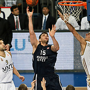 Anadolu Efes's Estaban Batista (C) and Real Madrid's Felipe Reyes (L) during their Turkish Airlines Euroleague Basketball Group C Game 10 match Anadolu Efes between Real Madrid at Sinan Erdem Arena in Istanbul, Turkey, Thursday, December 22, 2011. Photo by TURKPIX