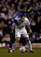 Photo: Jed Wee.<br /> Leeds United v Crystal Palace. Coca Cola Championship. 21/03/2006.<br /> <br /> Leeds' Robbie Blake (R) holds off Crystal Palace's Mikele Leigertwood.