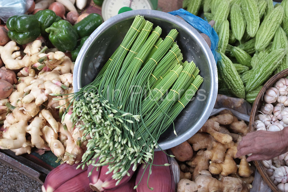 Vegetables for sale at Phsar Kandal morning market in Phnom Penh, the capital city of Cambodia. A large variety of local products are available for sale in fresh markets all over Cambodia, all being sold on small individual stalls.