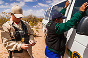 22 APRIL 2003 - SELLS, ARIZONA: Undocumented immigrants in custody of the US Border Patrol are walked out of the desert on the Tohono O'Odham reservation south of Sells, AZ. The Tohono O'Odham reservation, which spans much of the southern Arizona border with Mexico, was a major crossing point for undocumented immigrants after urban entry points, like Nogales, AZ, and Douglas, AZ, were shut down.          PHOTO BY JACK KURTZ