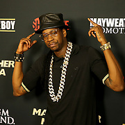 Rapper 2 Chainz is seen on the red carpet prior to the Mayweather versus Maidana boxing match at the MGM Grand hotel on Saturday, May 3, 2014 in Las Vegas, Nevada.  (AP Photo/Alex Menendez)