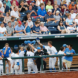 Jun 25, 2013; Omaha, NE, USA; UCLA Bruins huddles up during the third inning in game 2 of the College World Series finals against the Mississippi State Bulldogs at TD Ameritrade Park. Mandatory Credit: Derick E. Hingle-USA TODAY Sports