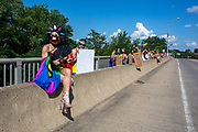 Participants in the Milton Pride Rally hold signs and pride flags on the river bridge in Milton, Pennsylvania on August 8, 2020. The I Am Alliance organized the event to show support for the LGBTQ community.