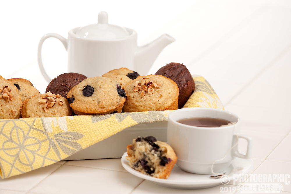 Different muffins served with tea