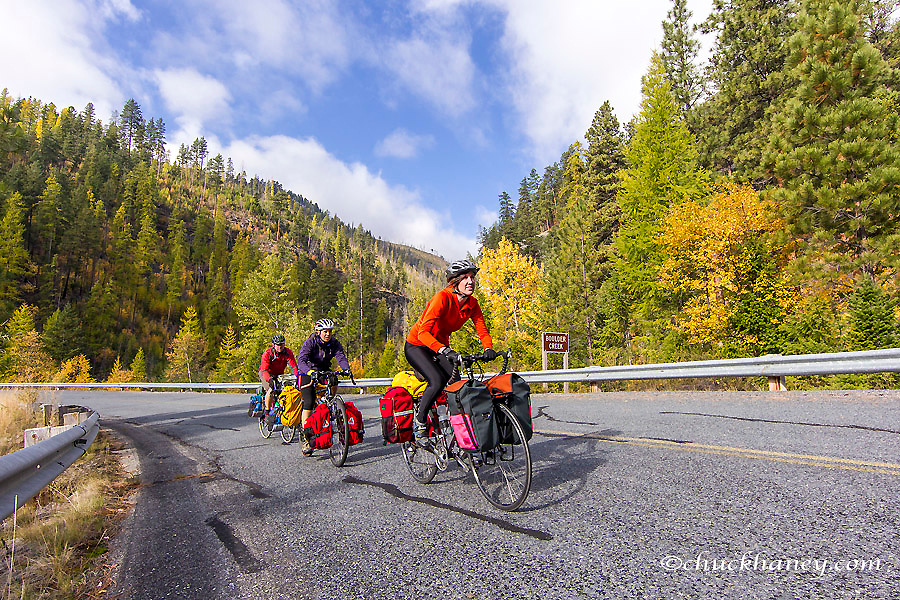 Bike touring in autumn color above Lake Koocanusa in the Kootenai National Forest, Montana, USA model released