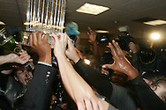 HOUSTON - OCTOBER 26:  The World Series trophy is passed around the clubhouse after Game 4 of the 2005 World Series against the Houston Astros at Minute Maid Park on October 26, 2005 in Chicago, Illinois.  The White Sox defeated the Astros 1-0.