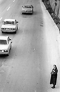Nun attempting to cross the road. Beirut, Lebanon.