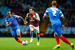 Joe Cole of Aston Villa is challenged by Jay Simpson of Leyton Orient - Photo mandatory by-line: Rogan Thomson/JMP - 07966 386802 - 27/08/2014 - SPORT - FOOTBALL - Villa Park, Birmingham - Aston Villa v Leyton Orient - Capital One Cup Round 2.
