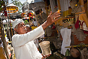 "Apr. 22 - UBUD, BALI, INDONESIA: Family members bless their temple during an Odalan ceremony in a family temple in Ubud, Bali, Indonesia. The Odalan ceremony is the ""birthday"" ceremony for Hindu temples in Bali and are held every 210 days. They are common in Bali.   Photo by Jack Kurtz/ZUMA Press."