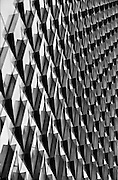 Pattern of windows which are angled out the glass façade of Ropemaker Place, London<br /> <br /> Architect: Arup Associates