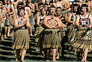 Maori women dancing at tribal gathering at the Marae in New Zealand