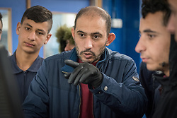 25 February 2020, Jerusalem: Teacher Yusef Hidmi leads auto-mechanics class at the vocational training centre in Beit Hanina. The Lutheran World Federation's vocational training centre in Beit Hanina offers vocational training for Palestinian youth across a range of different professions, providing them with the tools needed to improve their chances of finding work.