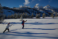 Russell Laman (age 12) and Jessica Laman (age 9)  cross-country skiing below the Teton Range.<br />