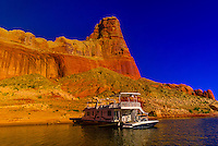 75 foot luxury-class houseboat (Lake Powell Resorts & Marinas) anchored along Lake Powell (with Gunsight Butte in background), Glen Canyon National Recreation Area, Arizona/Utah border USA