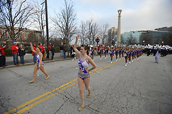 Marching bands, floats and dignitaries make their way down Andrew Young International Boulevard for the annual Chick-fil-A Peach Bowl Parade where Ole Miss will face TCU in their SEC vs. Big 12 football game on December 31, 2014. David Tulis / Abell Images for the Chick-fil-A Peach Bowl