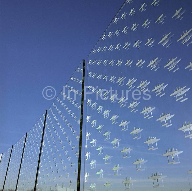 'Counting the Cost' is a memorial sculpture in glass designed by Renato Niemis which is outside at the American Air Museum at the Imperial War Museum, RAF Duxford, England. The sculpture comprises of 52 toughened clear float glass panels, each etched with the outlines of 7,031 aircraft missing in action in operations flown by American air forces (Air Force and Navy Groups) from Britain during the Second World War. The images are scaled at 1:240, diagonally pointing towards the blue summer sky once filled with bombers and fighters during the air campaign over Germany and France. Picture from the 'Plane Pictures' project, a celebration of aviation aesthetics and flying culture, 100 years after the Wright brothers first 12 seconds/120 feet powered flight at Kitty Hawk,1903.