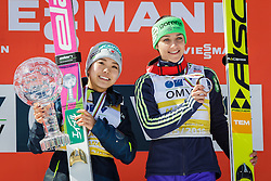 Overall World Cup winner Sara Takanashi (JPN) celebrates with a globe and third placed Maja Vtic (SLO) during final trophy ceremony after the Ski Flying Hill Team Competition at Day 4 of FIS Ski Jumping World Cup Final 2016, on March 20, 2016 in Planica, Slovenia. Photo by Ziga Zupan / Sportida