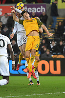 Football - 2017 / 2018 Premier League - Swansea City vs. Brighton & Hove Albion<br /> <br /> Olie Mcburnie of Swansea City & Lewis Dunk of Brighton and Hove Albion challenge for the ball, at The Liberty Stadium.<br /> <br /> COLORSPORT/WINSTON BYNORTH