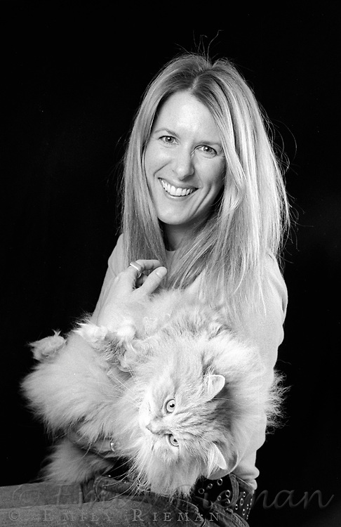 Portraits of people with their pets shot on black and white film.